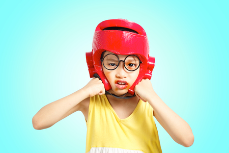 Little girl boxing action with headguard and injured face. Clipping path