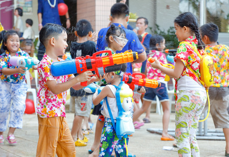 Bangkok, Thailand - April 11, 2018 - Children play water gun in Songkran festival at Panchasap minburi school