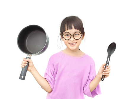 Little asian girl hold up with pot and turner iisolated on white background