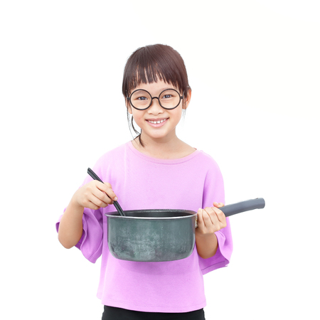 Little asian girl cooking with pot and turner iisolated on white background