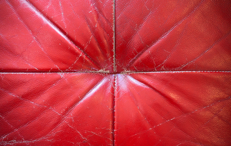 Red old leather sofa closeup aged texture Stock Photo
