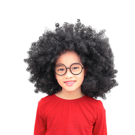 Young beautiful chinese asian girl with an afro hairstyle. Smiling girl wearing eyeglasses. Isolated on white background