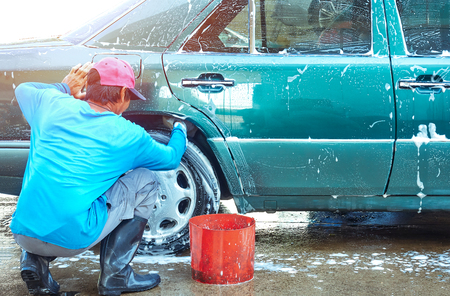 washing car by man worker Stock Photo
