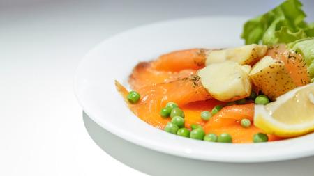 salmon gravlax on white dish