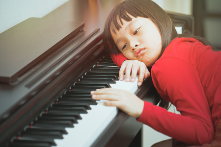 The girl bored to leaning piano Stok Fotoğraf