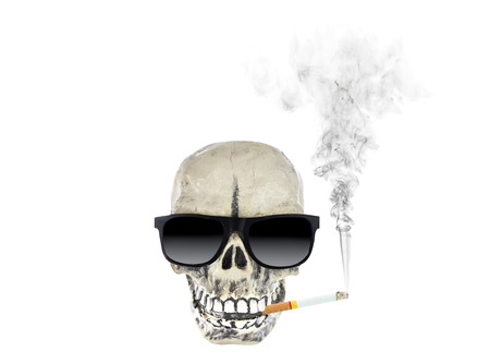 cigarette and skull isolated on white background. Stok Fotoğraf