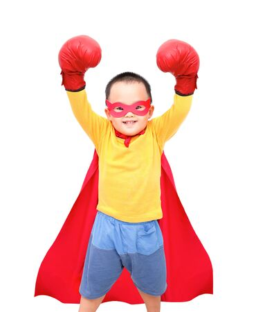Little boy wear super  hero costume and boxing glove fist. Isolated on white background.