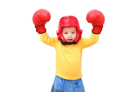 Little boy wear headguard and boxing gloves. isolated on white background.