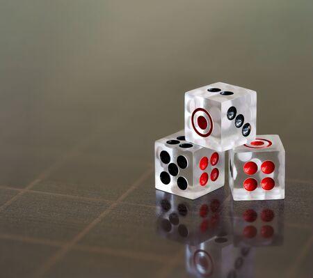 Transparent acrylic  dice isolated on dark background