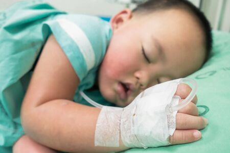 Children sleep on the hospital bed with saline solution.