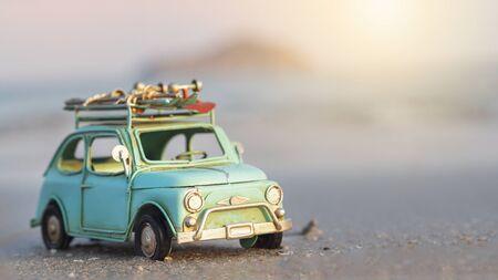 Miniature tin car closeup at summer beach scene Reklamní fotografie