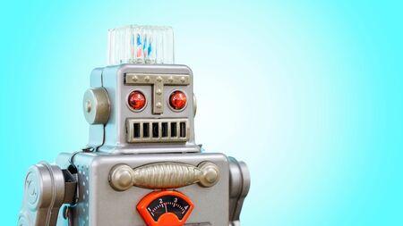 Retro robot tin toy isolated on blue background