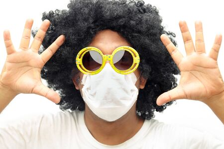 A man afro hair style is wearing a big yellow glasses with fabric mask, Isolated from white background.