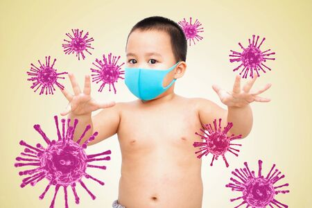 Little boy wearing a fabric mask with virus 3D render graphic, and show stop hands gesture for stop corona virus outbreak. Isolated  background.