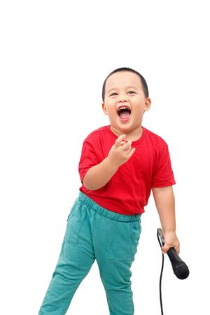 The little boy held the microphone, singing a song with a smiling and happy face. Isolated on white background.