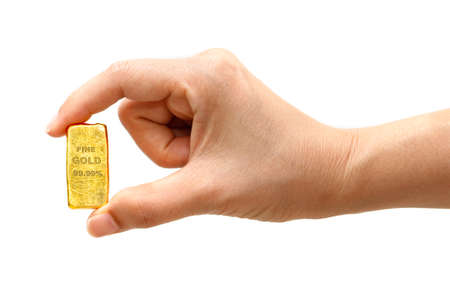Woman hand holding a gold bar to take a close up photo