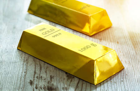 Big gold bar on a wood floor.
