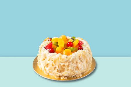 Fruit cake with almonds cream isolated on blue background. Stockfoto