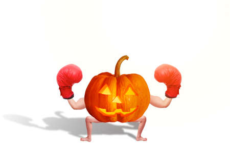 Halloween pumpkin Decorate the image of the human arms and legs, wearing a boxing glove. Isolated on white background