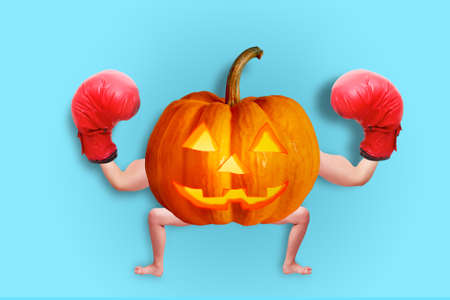 Halloween pumpkin Decorate the image of the human arms and legs, wearing a boxing glove.