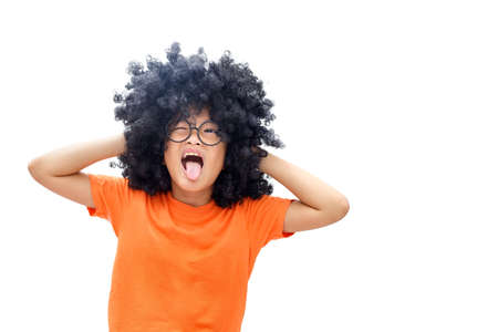 The image of a young Asian girl with an Afro-haired hairstyle shows an extremely angry expression. Isolated on white background