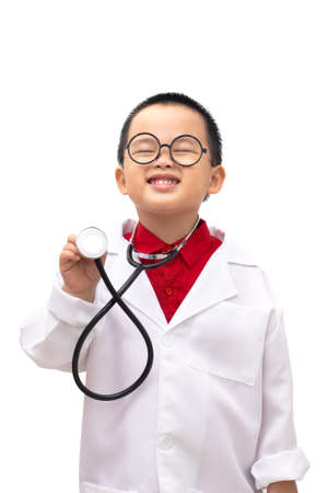 Boy wearing a doctor uniform And holding a stethoscope. Isolated on white background Stockfoto