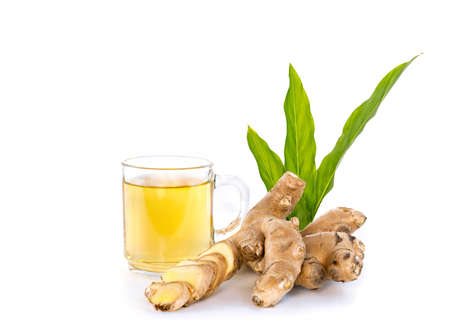Ginger tea with rhizomes and leaves isolated on white background.