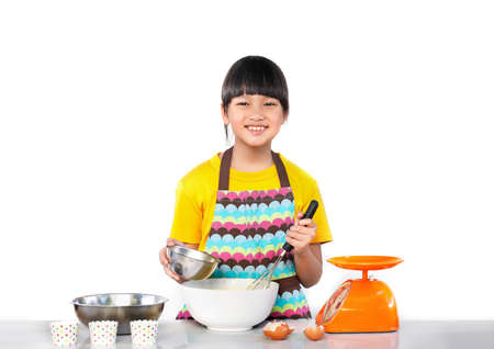 Asian girl making pastries in the kitchen. Isolated white background