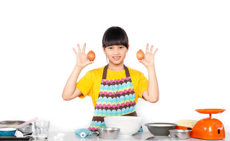 Asian girls making pastries in the kitchen.