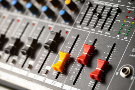 Closeup sound mixing console channel volume.