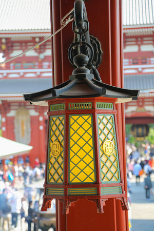 a righteous person: An old colorful Japanese lamp hanging on a pole at Asakusa Shrine.