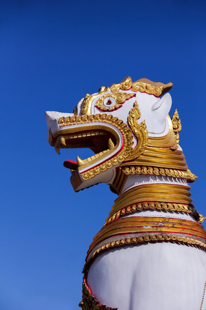 A big sculpture of white guardian lion in Thailand