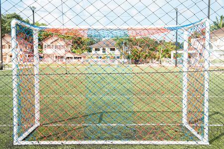 Goal post on green field ,white line football corner on green field. 스톡 콘텐츠