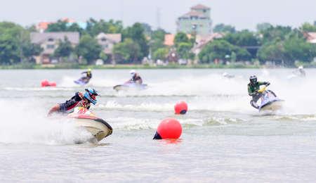 jet skier: KHON KAEN THAILAND - SEPTEMBER 13: Unidentified jet ski racer in race: Jetski Northeastern Thailand Championship 2015 at Nongkot Beach on Sep 13, 2015 in Khon Kaen, Thailand. Khon Kaen is the fifth-largest of the north-eastern provinces of Thailand.