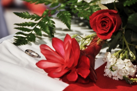 fateful: The ring, the symbol of a promise of eternity, among the flowers in the bouquet, which awaits the fateful