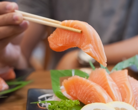 Sashimi with chop sticks  Stock Photo