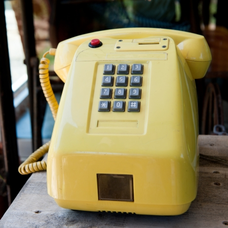 vintage orange telephone Stock Photo - 20480076