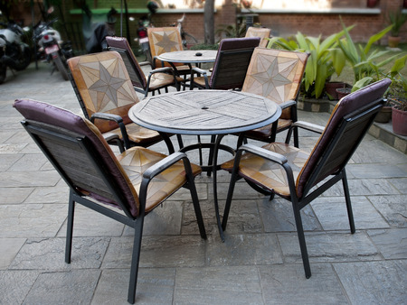 fine cane: wooden table and chairs - garden furniture. Stock Photo