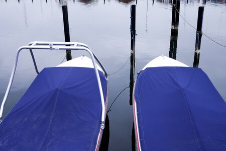 Two boats laying beside each other with blue overlays Zdjęcie Seryjne