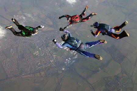 fallschirm: Vier Fallschirmspringer Lizenzfreie Bilder