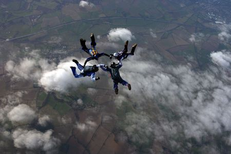 skydive: Four Skydivers building a formation