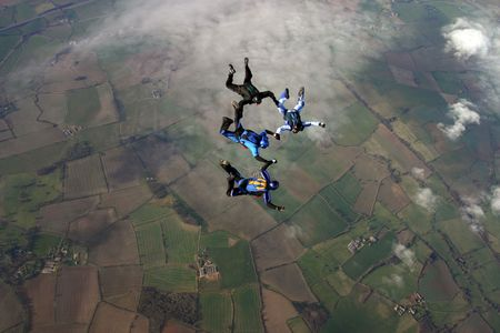 Four Skydivers building a formation Stock Photo - 2464672
