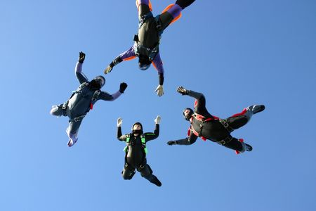 skydive: Four Skydivers building a star formation