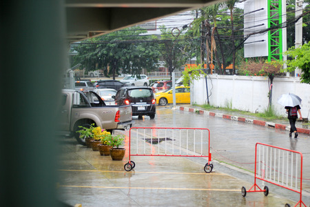 urbanism: traffic ,view through the window on rainy day
