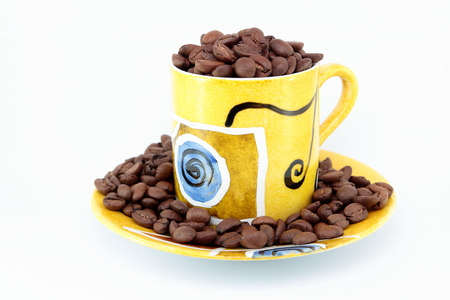 coffe beans: Cup full of coffe beans Stock Photo