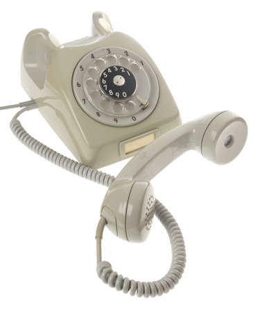 retro telephone: old gray vintage rotary style telephone off the hook
