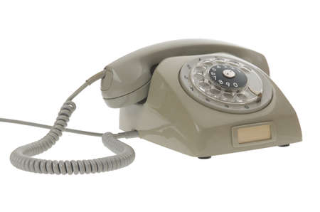 dialplate: old gray vintage rotary style telephone isolated on white