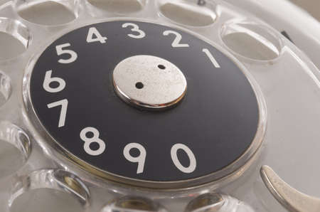 dialplate: a closeup of an old phone dialing ring