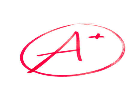 A handwritten grade for an excellent achievementsin red ink  Isolated on white Stock Photo - 12409180