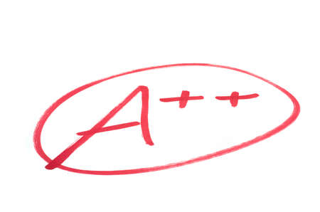 A handwritten grade for an excellent achievementsin red ink  Isolated on white  Stock Photo - 12409177
